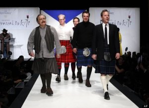 "Hot Scots mingled with some of Nashville's elite at this year's ""Dressed to Kilt,"" the annual Scottish-tinged fashion show and charity fundraiser, held Tuesday night at New York's Hammerstein Ballroom. In keeping with this year's ""country chic"" theme, the event's featured designers -- which included Vivienne Westwood along with a bevy of up-and-coming European talents -- lent many of their Caledonian-inspired designs a down-home Texas flair. And while tartan and tweed might seem questionable when paired with a ten-gallon hat and cowboy boots, organizers and attendees alike were quick to draw attention to country music's early connection to the Scottish Highlands. The event drew more than a few high-profile, and occasionally eyebrow-raising, participants -- among them Danny Ware and Ahmad Bradshaw of the New York Giants, both of whom looked surprisingly natural in kilts, as well as country artist Gary Allan and ""Gossip Girl"" actor Matthew Settle, who teased the judges with a flash of leg before strutting down the catwalk. Donald Trump and wife Melania, neither of whom donned plaid, caused the biggest commotion on the red carpet before breezing by reporters and being quickly ushered to their seats."