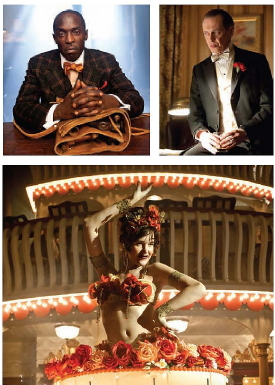 """John Dunn began researching costumes for HBO's Boardwalk Empire by scouring the legendary libraries at the Fashion Institute of Technology, the Metropolitan Museum of Art, and the Brooklyn Museum, as well as photographs inside the Library of Congress. Executive Producer Martin Scorsese even compiled a 1920s film reel for the costume designer, who also visited New York vintage shops and Los Angeles costume warehouses. """"That's what really informed us about the construction, the fabrics, materials, details, colors. And the latter was really eye-opening,"""" says Dunn, who was Emmy-nominated for the first season of Mad Men """"We are so used to looking at that period in black-and-white films and sepia photos. Not a lot of the original color survived. But if you take apart a hem or a seam in a vintage garment, you're like, 'Holy Cow! Look at that color!' It was not a drab period at all. We were amazed by the colors even the men were wearing back then."""" Dunn used only authentic fabrics, nothing that did not exist in 1920, and often had to have fabrics specially woven for the men's suits to get the proper period weight and texture. Steve Buscemi's clothing was custom-made by master tailor Martin Greenfield, who could turn out a suit for the show in just four days, often in triplicate. -- Read more about John Dunn HERE  This Article was written by Elizabeth Snead @ deadline.com"""