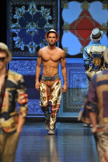 """Edited by Antonella Ciancio, Reuters  MILAN – Fashion designers at the Milan menswear week opted for untied shirts, raffia hats and crocodile espadrilles for next summer to lighten up the wardrobes of men who dress to impress. Milan's holiday-themed collections brought a whiff of fresh air into the fashion industry, which is undergoing an intense round of consolidation and bourse listings. Luxury groups Prada and Salvatore Ferragamo are aiming to raise as much as $2.67 billion in their initial public share offerings, or IPOs, this month. """"It's fantastic to see all these projects that are warming up the market. Investors' interest shows that the fashion industry is growing,"""" Gianluca Brozzetti, Chief Executive of Italian fashion house Roberto Cavalli, told Reuters. Trendsetter designer Miuccia Prada, back from a fashion show in Hong Kong for IPO investors, delivered in Milan a carefree collection inspired by golf courses, with ironic shirts in cartoon and floral prints playing with tailored suits. The fashion industry, a key contributor to Italy's economy, is expected to generate 65 billion euros ($93 billion US) this year, according to Italy's Chamber of Fashion, up 7% from 2010. At Ferragamo, designer Massimiliano Giornetti brought guests to the French Riviera for his laidback collection, with models in raffia panama hats and close-fitting suits in creamy colours. A scent of the Riviera also reached Ermenegildo Zegna, featuring crinkled silk jackets in muted bleached colours. ...See more Photos and Read more -- CLICK HERE"""