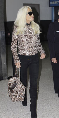 One of the coolest (and coldest blooded) trends to have slipped off the Autumn Winter runways was coloured snakeskin. Now queen of fashion, Donatella Versace, has gone for a controversial matchy-matchy accessories look by pairing her jacket to her holdall on a recent flight. To help water-proof our theory, here's Anna Wintour in a bottle green snakeskin mac, making her way to the Burberry show at London Fashion Week.
