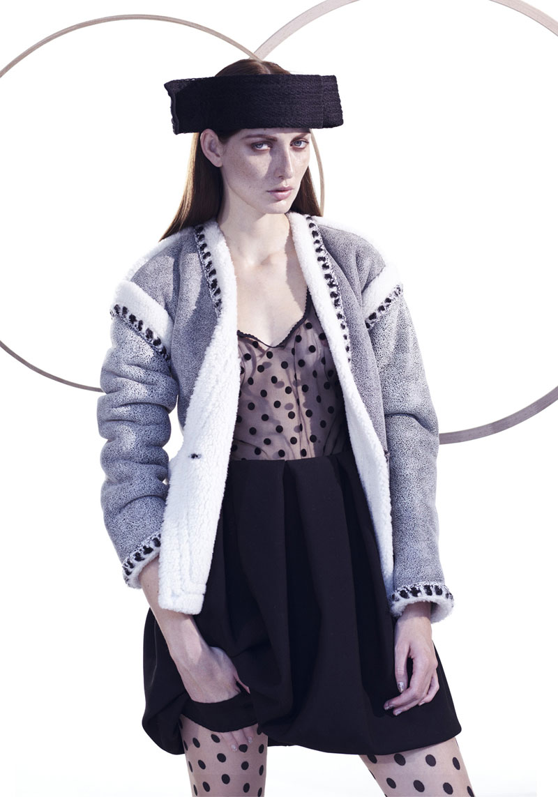 Xanesra – A stoic Tatiana Chechetova dons dark autumn-winter looks for Laurens Rossner's striking images shot for Fashion Gone Rogue's latest exclusive. Styled by Katharina Gruszczynski, Tatiana gets swathed in the designs of Jil Sander, Miu Miu, Chanel and others with bold statement pieces in the form of hats and handbags. Sleek, straight hair and a natural face by Arzu Küçük gives the brunette beauty a cool yet elegant touch.